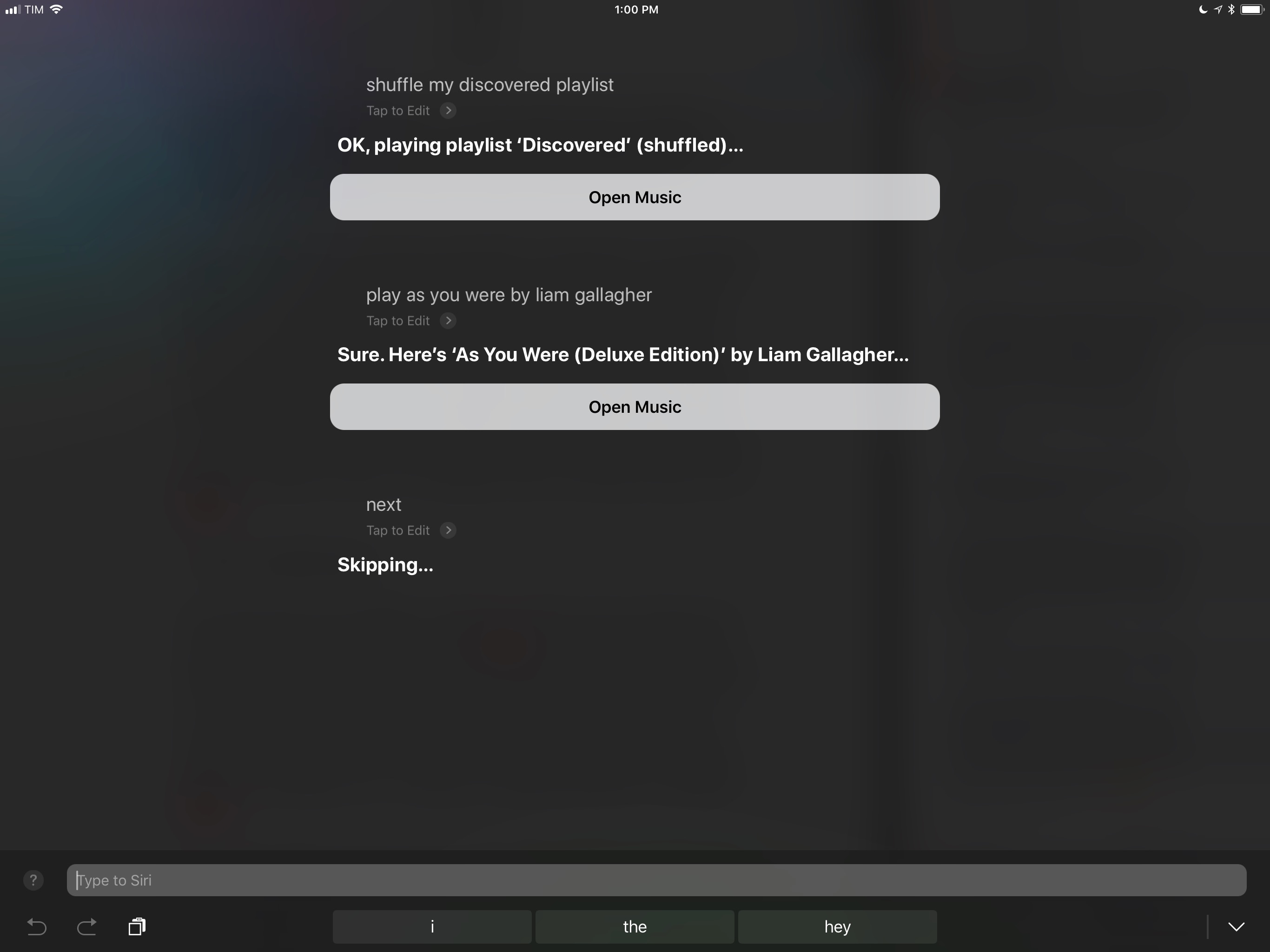 Controlling music playback with Type to Siri.