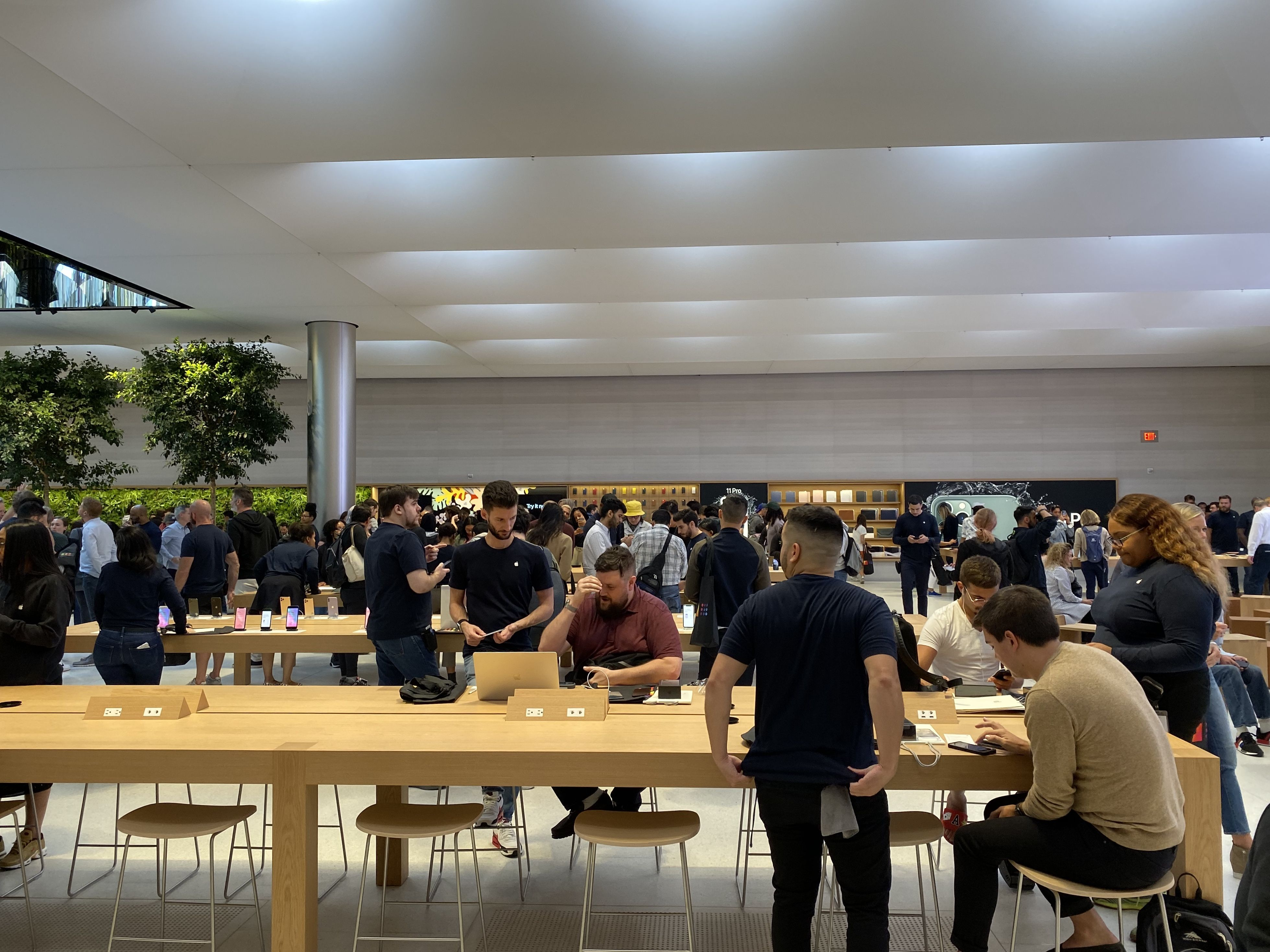 Apple retail staff doing their thing.